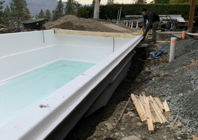 Shoring up the sides of a new pool.