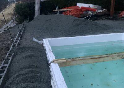 Gravel around the edge of a pool.