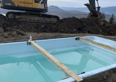 Otter Pool installation with an excavator in action.